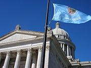 Oklahoma state capitol and flag